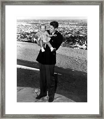 Ronald Reagan Holding Maureen Reagan Framed Print by Everett