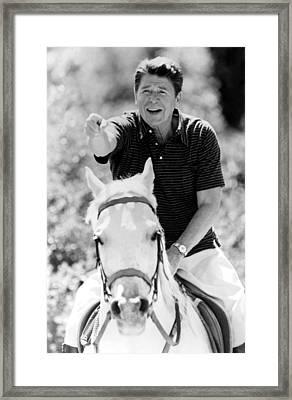 Ronald Reagan On Horseback Framed Print by Everett