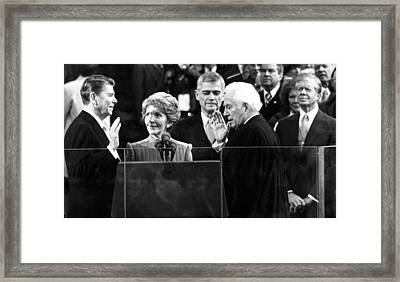Ronald Reagan Sworn In As President Framed Print by Everett