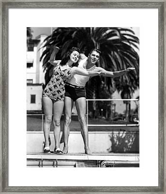 Ronald Reagan Uses His Lifeguard Framed Print by Everett