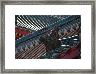 Rooftop Dragon Framed Print by Bonnie Myszka