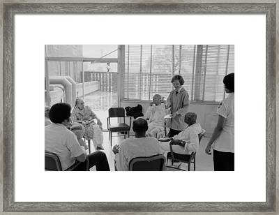 Rosalynn Carter Works With Staff Framed Print by Everett