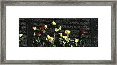Roses Are Left At The Vietnam Veterans Framed Print