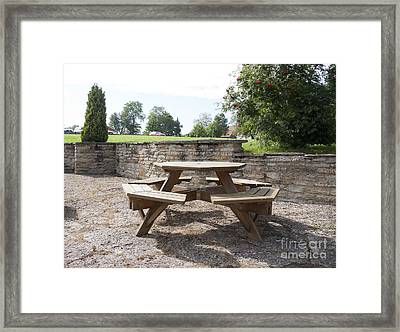 Round Outdoor Table Framed Print by Jaak Nilson
