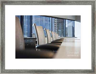 Row Of Chairs And A Table In A Conference Room Framed Print by Jetta Productions, Inc