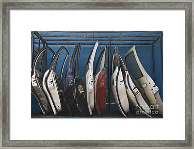 Row Of Dismantled Car Doors Framed Print by Noam Armonn