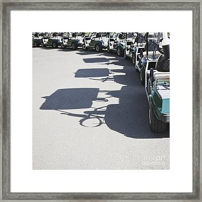 Row Of Empty Golf Carts Framed Print by Jetta Productions, Inc