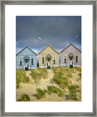 Row Of Pastel Colored Beach Cottages Framed Print by Jill Battaglia