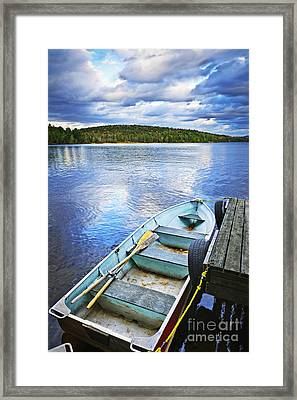 Rowboat Docked On Lake Framed Print
