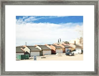 Rows Of Duplex Garages Framed Print by Eddy Joaquim