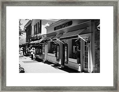 Rows Of Restaurants In The Historic Queen Street District Of Niagara-on-the-lake Ontario Canada Framed Print by Joe Fox