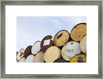 Rows Of Stacked Barrels Framed Print by Paul Edmondson