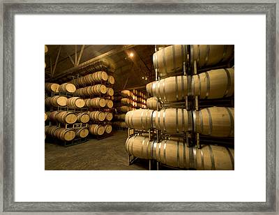 Rows Of Wine Barrels Stacked Framed Print