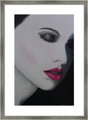 Ruby Lips Framed Print by David Hawkes