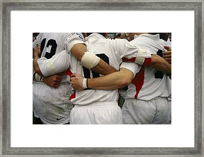 Rugby Players Huddle In A Scrum Framed Print by Justin Guariglia