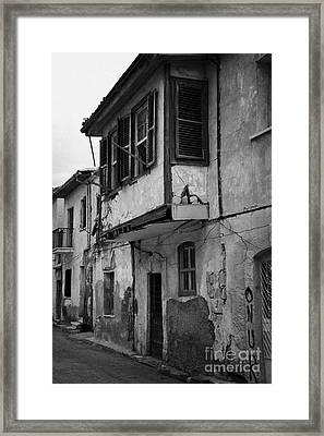 run down building with bay window in the old town of nicosia TRNC turkish republic northern cyprus Framed Print