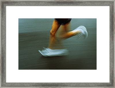 Running Framed Print by Kevin Curtis