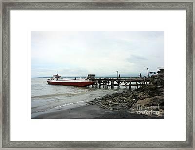 Rural Wharf Framed Print by Tony Magdaraog