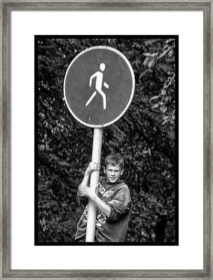 Framed Print featuring the photograph Russian Boy On Sign by Rick Bragan