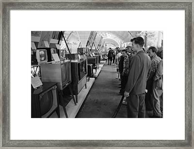 Russians Looking At Television Sets Framed Print by Everett