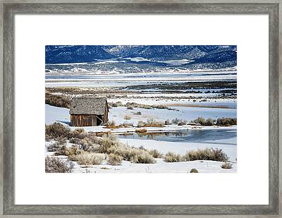 Rustic Barn In A Snowy Valley Next To A Pond Framed Print by C Thomas Willard