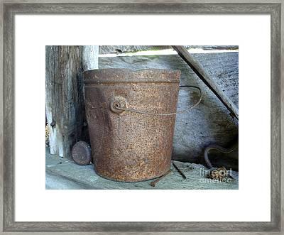 Rusty Bucket Framed Print