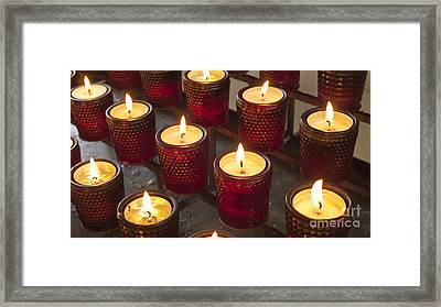 Sacrificial Candles Framed Print