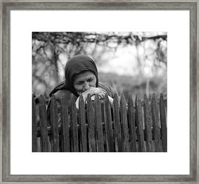 Sad Peasant At The Fence Framed Print