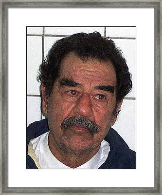 Saddam Hussein Shortly Framed Print by Everett
