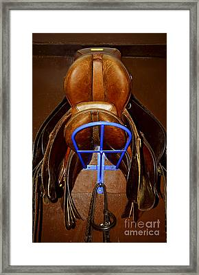 Saddles Framed Print