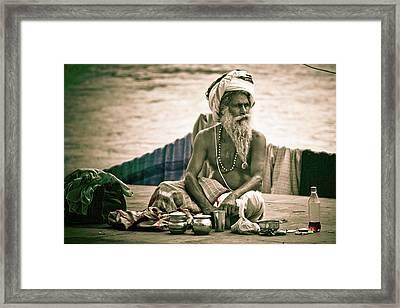 Sadhu At Ganges Framed Print by John Battaglino