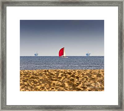 Sailboat And Oil Rigs On The Ocean Framed Print