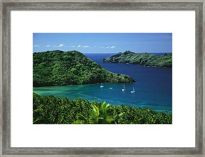 Sailboats Anchored In A Cove Of Blue Framed Print by Tim Laman