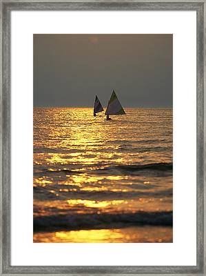 Sailboats Travel Across The Golden Framed Print by Skip Brown