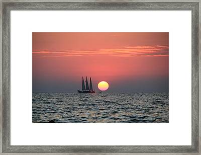 Sailing Away From The Sun Framed Print