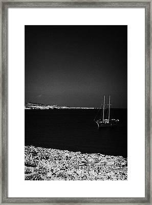 Sailing Boat Moored In A Quiet Bay Near Cape Gkreko Greco Republic Of Cyprus Framed Print by Joe Fox