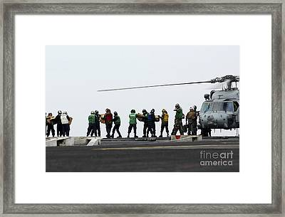 Sailors And Marines Load Supplies Onto Framed Print by Stocktrek Images