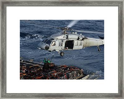 Sailors Attach Pallets Of Supplies Framed Print by Stocktrek Images