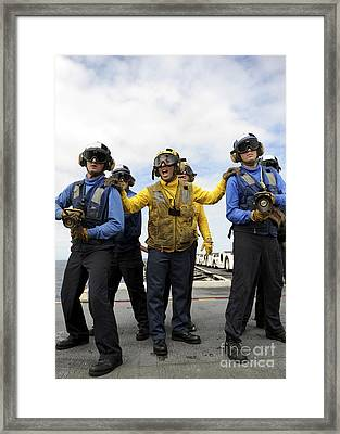 Sailors Fight A Simulated Fire Aboard Framed Print by Stocktrek Images