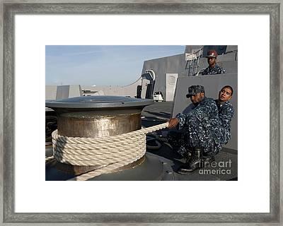 Sailors Handle Mooring Lines Aboard Uss Framed Print