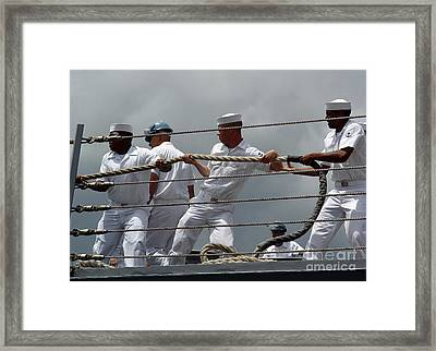 Sailors Heave Around On A Mooring Line Framed Print by Stocktrek Images