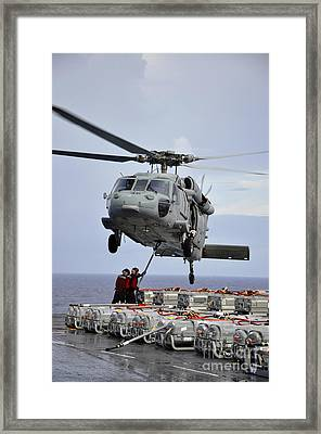 Sailors Hook An Ammunition Pallet To An Framed Print by Stocktrek Images