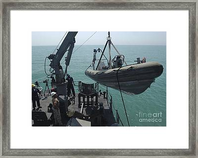 Sailors Lower A Rigid Hull Inflatable Framed Print by Stocktrek Images