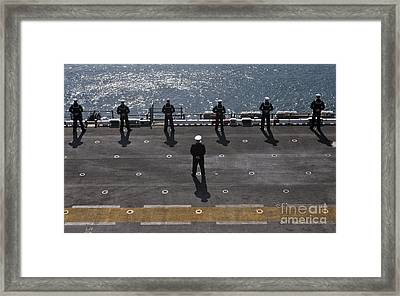 Sailors Man The Rails On The Amphibious Framed Print by Stocktrek Images