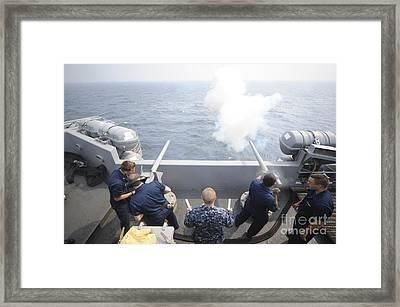 Sailors Perform A 21-gun Salute Aboard Framed Print by Stocktrek Images