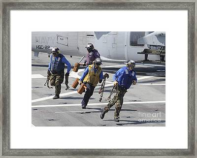 Sailors Remove The Chocks And Chains Framed Print by Stocktrek Images