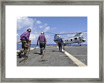 Sailors Rush To Chock And Chain Framed Print by Stocktrek Images