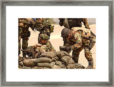 Sailors Stack Sand Bags Framed Print by Stocktrek Images