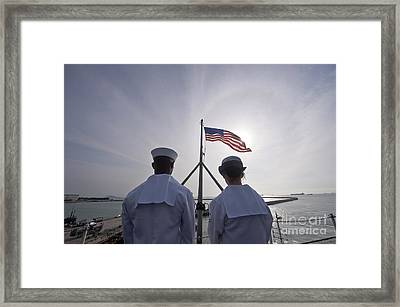 Sailors Stand By To Lower The Ensign Framed Print by Stocktrek Images