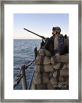 Sailors Stand Small Caliber Attack Team Framed Print by Stocktrek Images